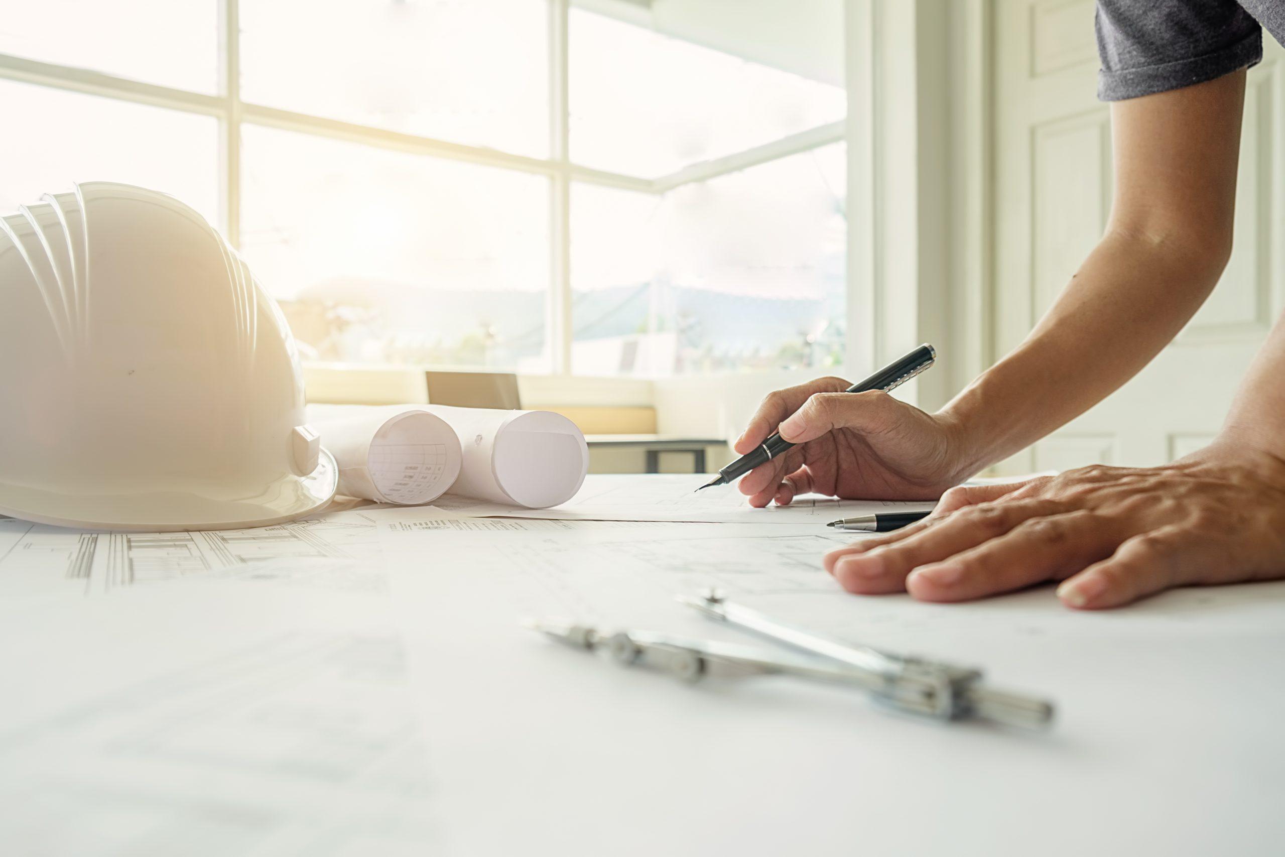 Hands_of_Engineer_Working_on_Blueprint